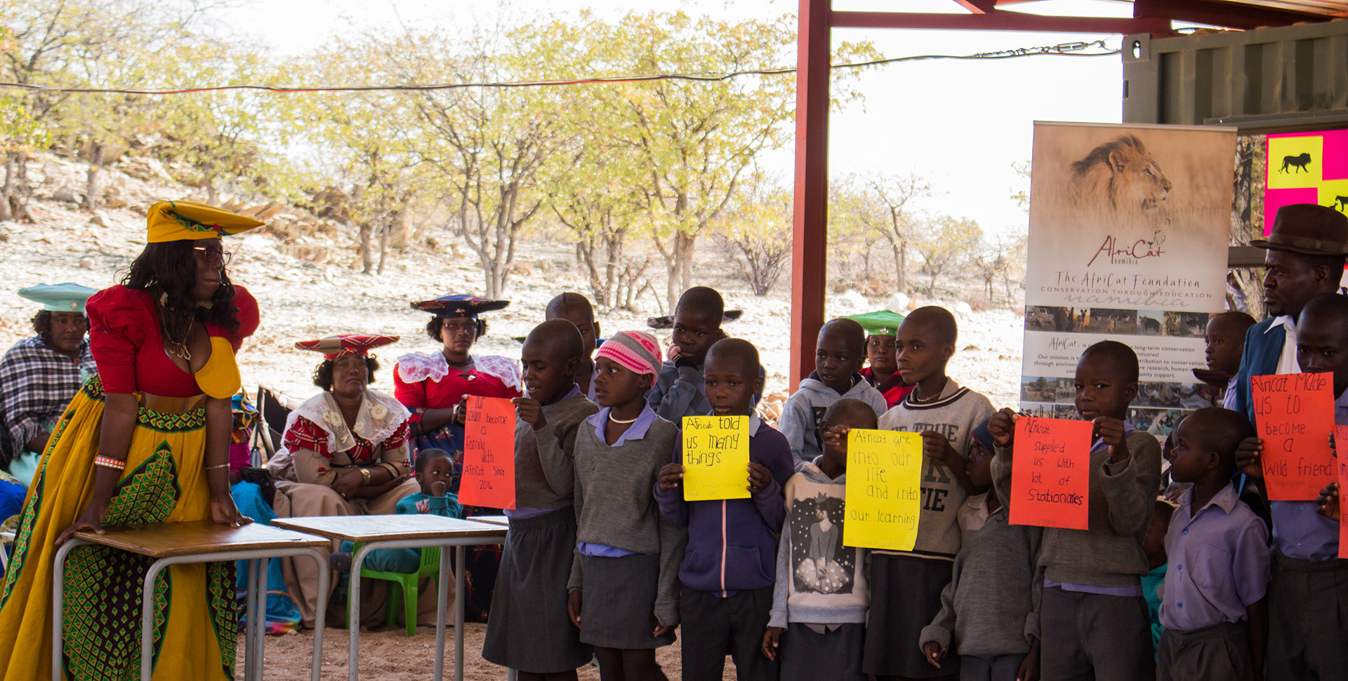 Onguta school children showing what they have learnt about lions